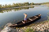 Boat Oarsman On River
