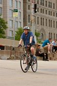 Elderly Man Rides Bicycle Along Lake Shore Drive
