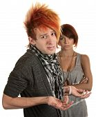 pic of gullible  - Young man with hunched shoulders and frustrated girlfriend - JPG