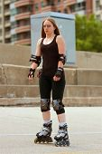 Woman Rollerblades Over Urban Asphalt Area