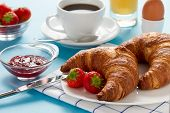 Breakfast with croissants, egg and coffee