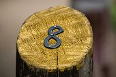 Number Eight On A Painted Wooden Post