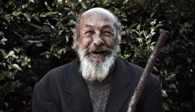 stock photo of sluts  - portrait of an elderly bearded man with a smile on face