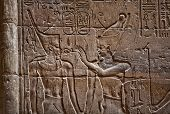 stock photo of ankh  - Relief depicting Egyptian divinity giving the Ankh to a pharaoh - JPG