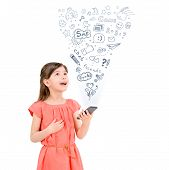 stock photo of fascinator  - Happy cute little girl in red dress holding an apple iphone in hand and fascinated looking up at the icons of different entertainment apps - JPG