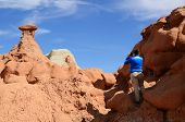 Photographer Shooting Sandstone Rock Formation (hoodoo) In Goblin Valley