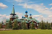 image of epiphany  - Wooden Church of the Epiphany on the green lawn in the village of Borodino near Moscow - JPG