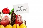 Ice-cream cake on white background with white card of mothers day