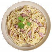 Spaghetti alla carbonara in beige pasta bowl.