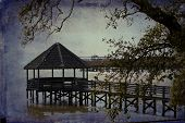 The gazebo in Currituck Heritage Park in historic Corolla, North Carolina is a popular vacation destination,  This is an artistic version of this location. poster