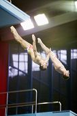 MOSCOW - APR 13: Athletes jump from tower at competitions on syncronized springboard diving in Pool
