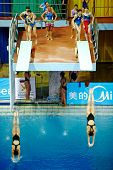 MOSCOW - APR 13:  Female athletes during competitions on  syncronized springboard diving in Pool of