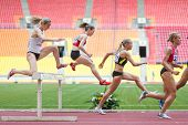 MOSCOW - JUN 11: Women each other overcome obstacle on International athletic competition Moscow Cha