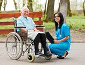 pic of wheelchair  - Happy elderly woman in wheelchair and kind nurse outdoors - JPG