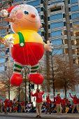 Parade Workers Guide Huge Float Down Atlanta Street