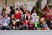 Spectators Look On In Anticipation At Atlanta Christmas Parade