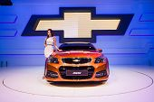 Unidentified modellings posted over chevrolet ss display on stage