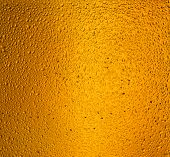 detail of beer in dewy glass as a backdrop