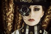 foto of cyborg  - Portrait of a beautiful steampunk woman over vintage background - JPG