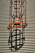 Corrugated steel grain bin ladder and cage cast a shadow