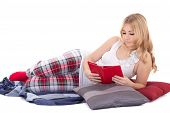 Pretty Girl In Pajamas Reading Book Isolated On White