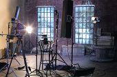 Studio with studio with brick walls and ragged windows, spotlights, camera with special devices for