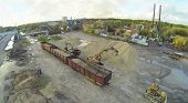 Excavators loaded sand into railway carriages. View from unmanned quadrocopter.