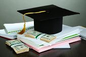 Money for graduation or training on wooden table on grey background