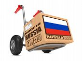 stock photo of free-trade  - Cardboard Box with Flag of Russia and Made in Russia Slogan on Hand Truck White Background - JPG