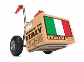 foto of free-trade  - Cardboard Box with Flag of Italy and Made in Italy Slogan on Hand Truck White Background - JPG