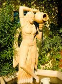 Stone Statue Of Indian Woman With A Water Pitcher