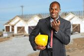 African American manager at construction site using radio