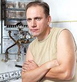 The man is upset the gas water heater has broken