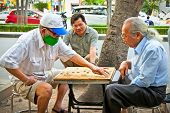 SAIGON, VIETNAM-NOVEMBER 17, 2013:Unidentified men playing board game  Xiangqi on November 17,2013 i
