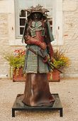 Bronze statue in the front of Chateau de Pommard winery in Burgundy, France