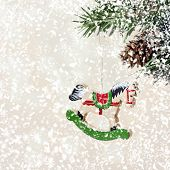 Christmas Card With Wooden Hourse On Fir Branches With Snow Decorations And With Falling White Snowf