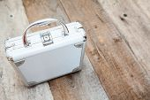 Aluminum Suitcase Standing On Wooden Floor, Copyspace