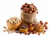 Hazelnuts, filbert on old wooden background