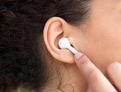 Female Ear With Earphone