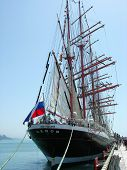 Sailship  Sedov  in port of  Sochi with flag.