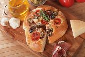 Italian focaccia bread with olives, rosemary and olive oil