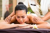 Indonesian Asian woman in wellness beauty day spa having aroma therapy massage with essential oil, l