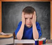 Tired School Child With Stress In Classroom
