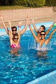 Happy young companionship having summer fun in outdoor swimming pool.