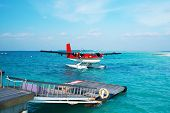 Twin otter red seaplane at Maldives