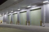 stock photo of roller door  - Exterior of factory with shutter door night time - JPG