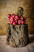 stock photo of red shallot  - Still Life With Shallots red onions on the timber.