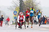Krakow, Poland - April 28 : Cracovia Marathon.handicapped Man Marathon Runners In A Wheelchair And O