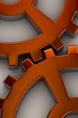 Interlocking gear wheels in orange over white background