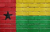 Flag of Guinea-Bissau painted onto a grunge brick wall